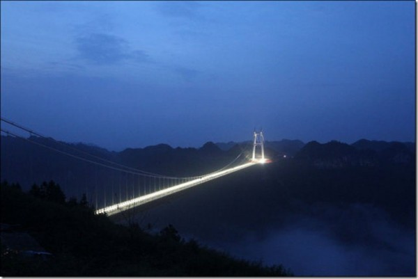 The bridge is lit up at night with 1,888 lights. It is the fourth suspension bridge to cross a valley so wide.