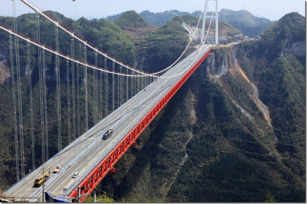 It seems to hang between two mountain ranges.  Once on the bridge traffic travels along a two-way, four-lane motorway at about 50mph.  Pedestrians can walk along it on a special walkway under the road.